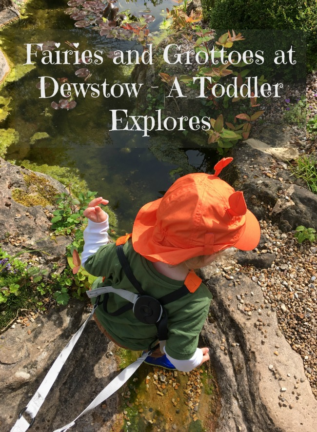 Toddler in stream and text over saying Fairies and Grottoes at Dewstow - A Toddler Explores