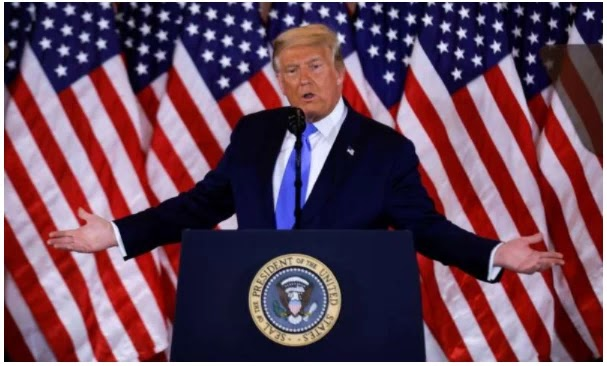 European leaders react cautiously as Trump falsely claims victory
