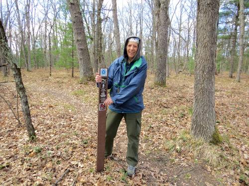 hiker at NCT carsonite post