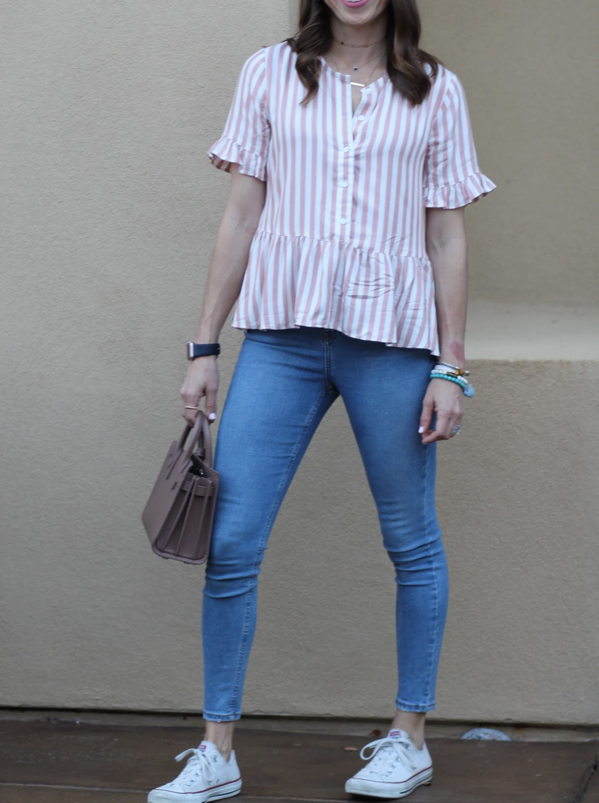 striped ruffle top and skinny jeans outfit