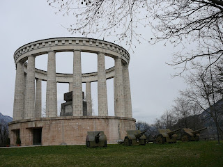 The Mausoleum housing Cesare Battisti's tomb stands on a rocky outcrop overlooking Trento