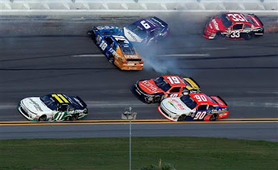 Darrell Wallace Jr #6 and Daniel Suarez #18 are involved in an on-track incident  as Blake Koch stays low to get by.