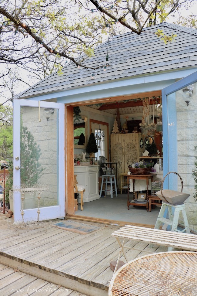 French Country is in the details with a French hip roof on a garden shed