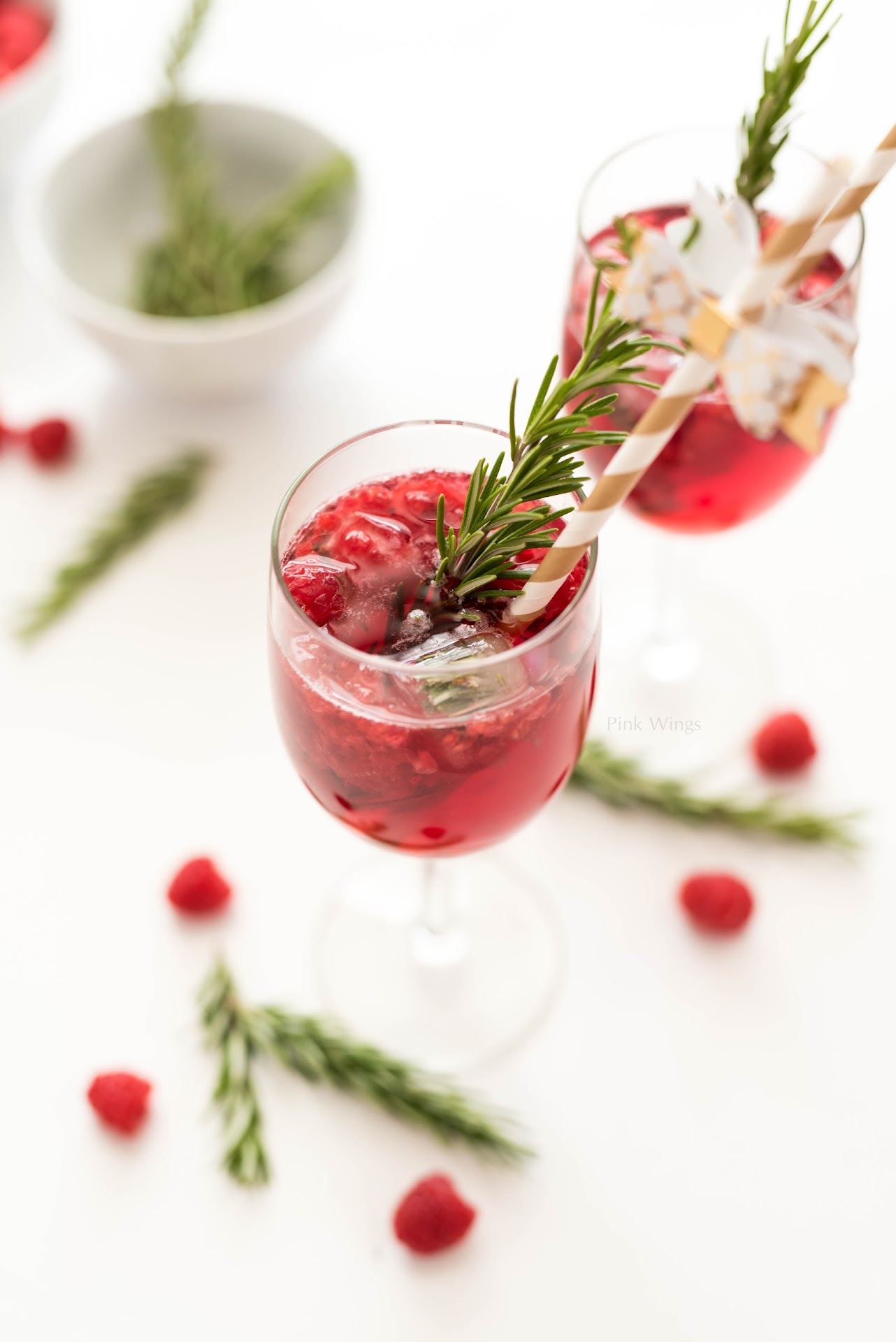 rosemary drink, cocktail recipe, mocktail, alcohol free, winter party drink, holiday party drink recipe, christmas, new year's, gold drink stirrers, cranberry juice, raspberry ice cubes, raspberry juice, san francisco california bay area blogger, mormon lds food blogger