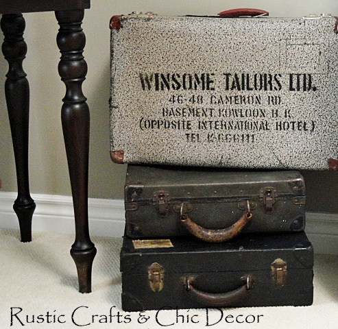 These dark vintage suitcases add rustic flare to the space.