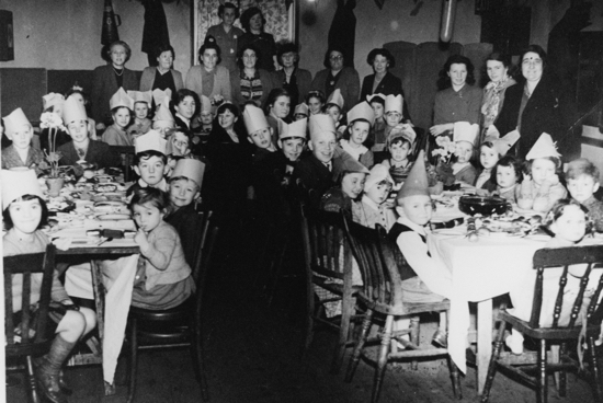 Photograph of a children's' xmas party in the scout hut in the 1950s - Image from E Maynard