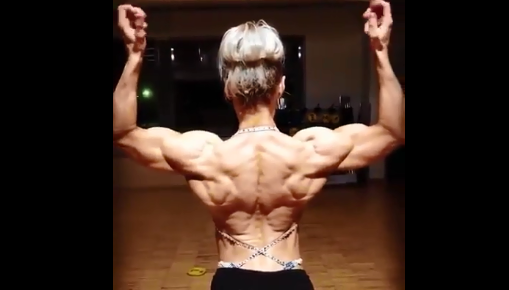 Video female bodybuilder biceps, triceps, delts-shoulders, forearms, chest, working
