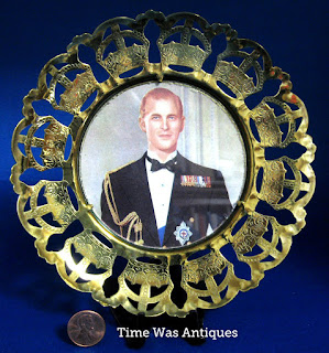 https://timewasantiques.net/products/coronation-plaque-prince-philip-1953-brass-crown-cut-out-rim-photo?_pos=1&_sid=2b3e4a726&_ss=r