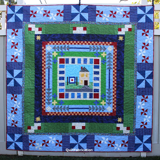 round robin quilt composed of different borders