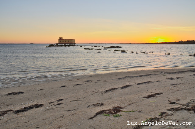 http://fineartamerica.com/featured/fuzeta-beach-sunset-scenery-and-landmark-portugal-angelo-deval.html