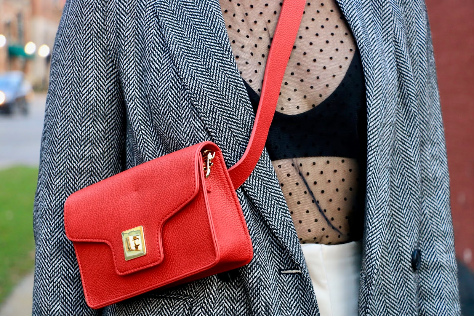Nyc fashion blogger Kathleen Harper wearing a red leather belt bag from Barney's.