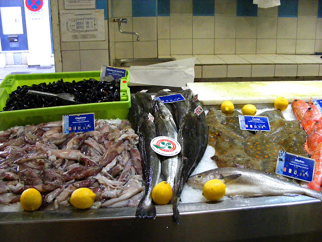 Farmed mussels (Fr. moules de bouchot), baby squid (Fr. chipiron), hake, plaice (Fr. carrelet) and whiting (Fr. merlan) at the fish market, Saint Jean de Luz. Pyrenees-Atlantiques. France. Photographed by Susan Walter. Tour the Loire Valley with a classic car and a private guide.