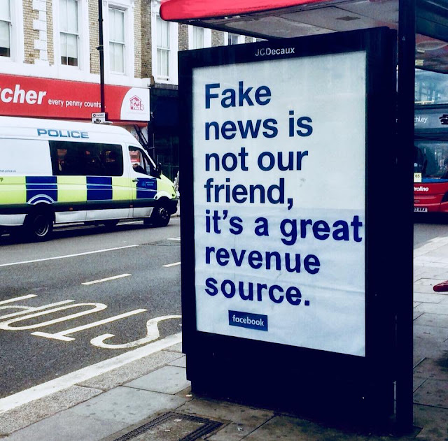 Fake news is not our friend, it's a great source of revenue. Highlighting a poster in UK by some protesters, who trying to shame Facebook by vandalising its ubiquitous 'not our friend' ads in London