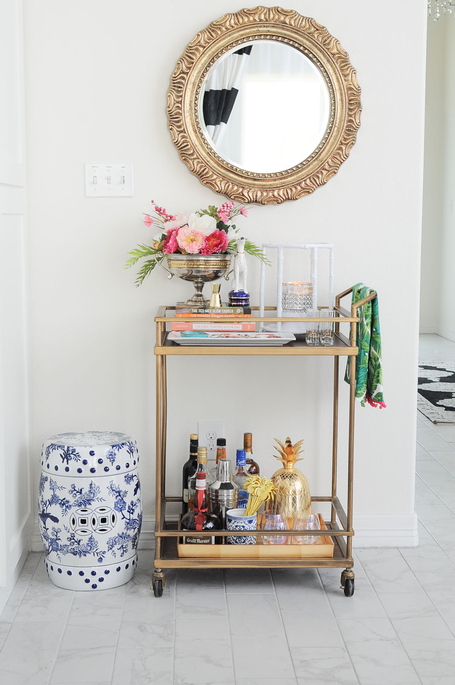 Gold bar cart styling tips and ideas for spring. Love the chinoiserie vibe and bright florals.