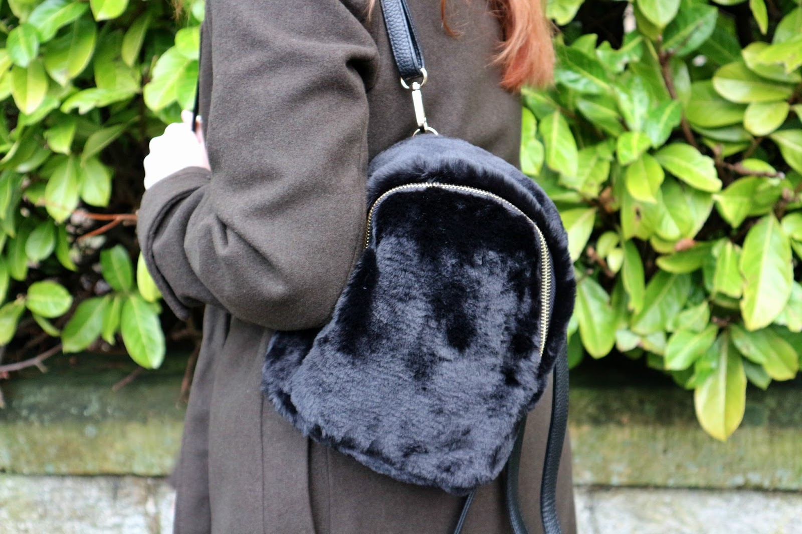 faux fur backpack UK
