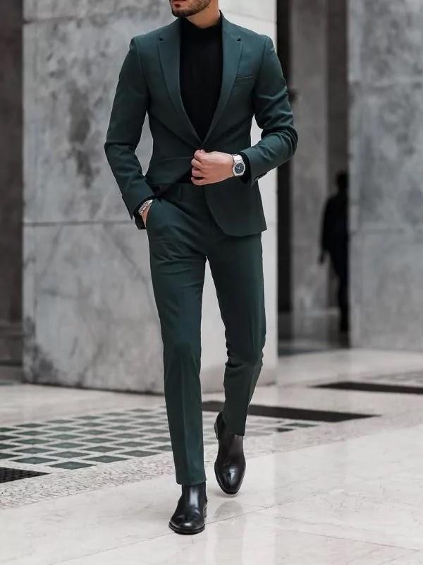 Teal colour suit with black turtleneck.