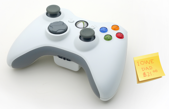 Game controller and IOU note.