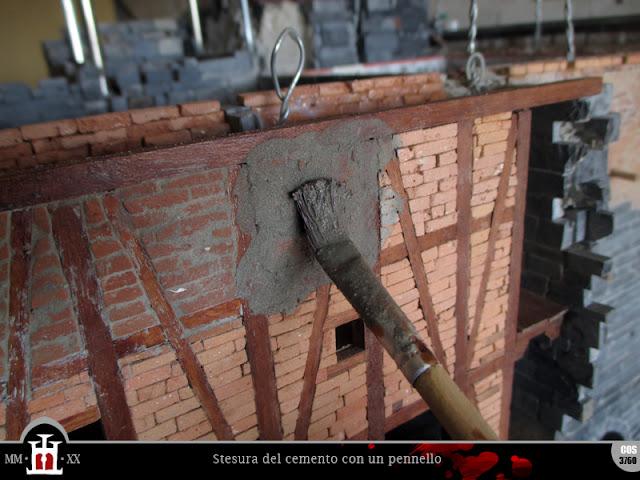 Stesura del cemento con un pennello