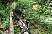 Pos Karang , Satgas Yonif Raider 100 PS Gelar Karya Bhakti Bersama  Masyarakat KampungYuwainda