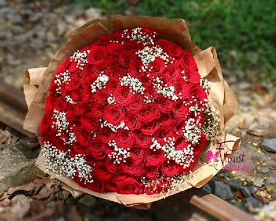 99 red rose arrangement