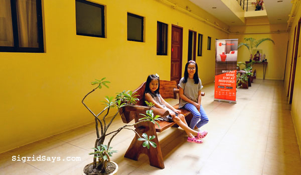 RedDoorz Bacolod East - Bacolod hotels - Bacolod blogger - family travel - Philippine destinations - Bacolod hotels - toiletries - hold and cold shower -homeschooling in Bacolod - parking lot - family room - hallway