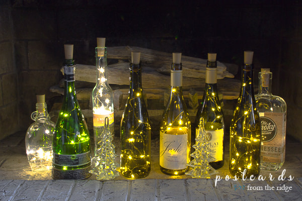 wine bottle lights inside a fireplace