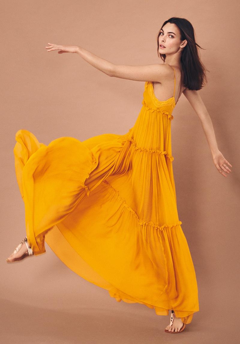 Alberta Ferretti features tiered maxi dress in spring-summer 2021 campaign.