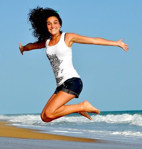 Jumping woman in sleeveless T-shirt and shorts.jpeg