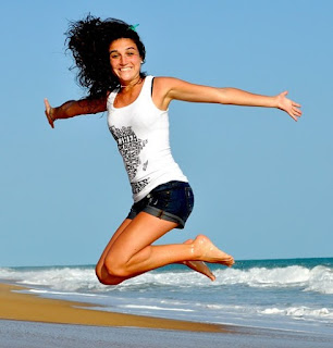 Jumping woman in sleeveless T-shirt and shorts.jpeg