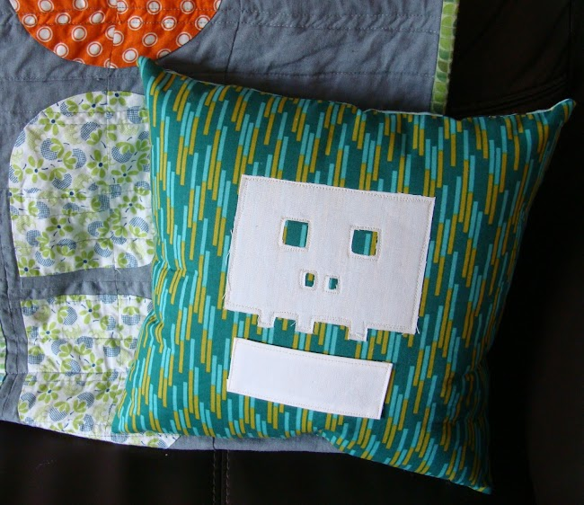 green cushion with white skull applique shape