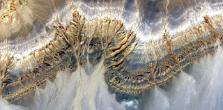 allegory caterpillar stone,abstract landscapes of deserts of Africa ,Abstract Naturalism,abstract photography deserts of Africa from the air,abstract surrealism,mirage in desert,