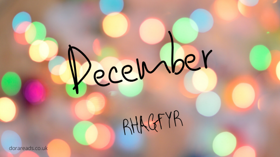 December - Rhagfyr with a sparkling/spotlight-type background