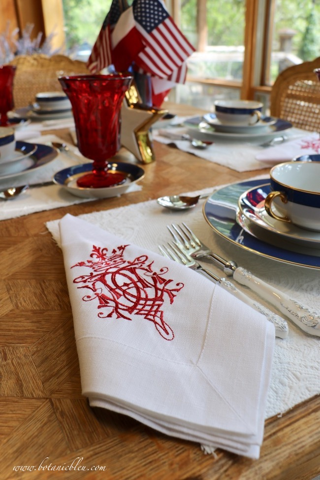 Labor Day patriotic French Country table setting with red crest linen napkins