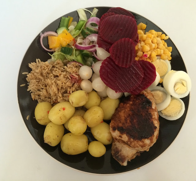 pork, egg, beetroot, brown rice, salad, pickled onion meal