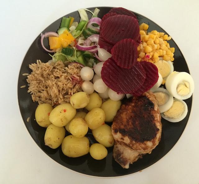 pork, egg, beetroot, brown rice, salad, pickled onion meal