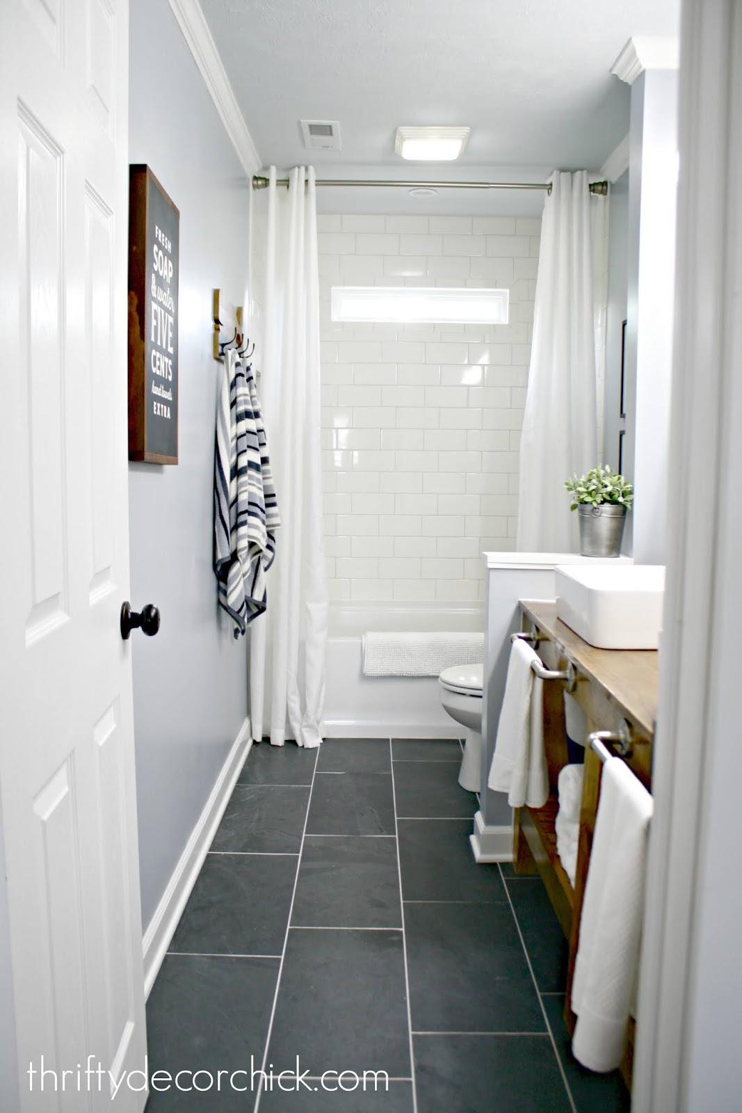 modern farmhouse bathroom with wall removed