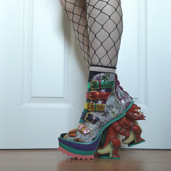 side view of legs in dinosaur heel boots in multi coloured metallic and floral patent uppers