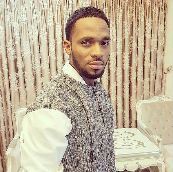 D'banj poses with his bodyguards, flaunts expensive jewelry