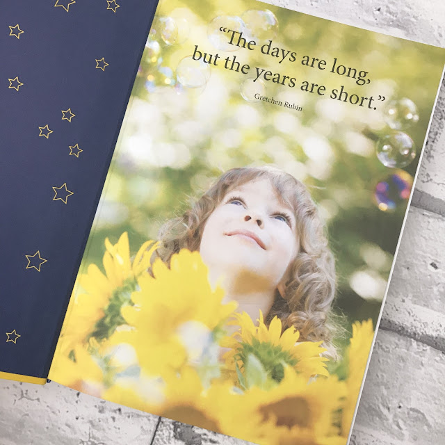 Inside the journal showing a picture of a little boy looking up at the sky with the text 'the days are long but the years are short'