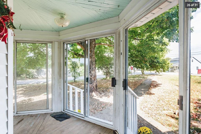 glass-enclosed front porch on Sears Silverdale kit house at 1793 Ruddles Mills Rd Paris Kentucky