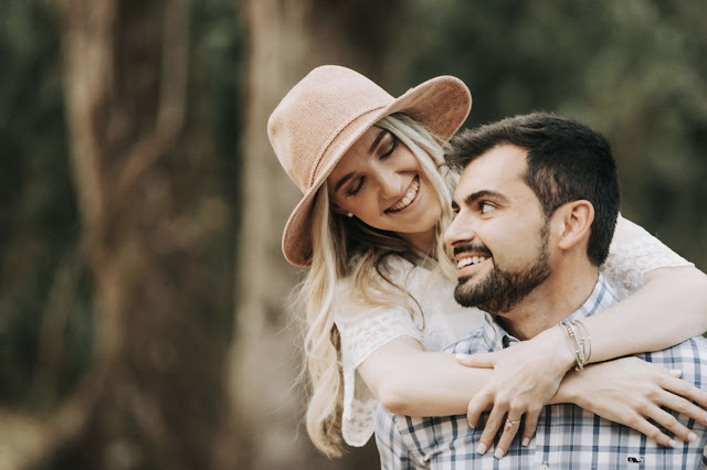 couple smiling for engagement photos