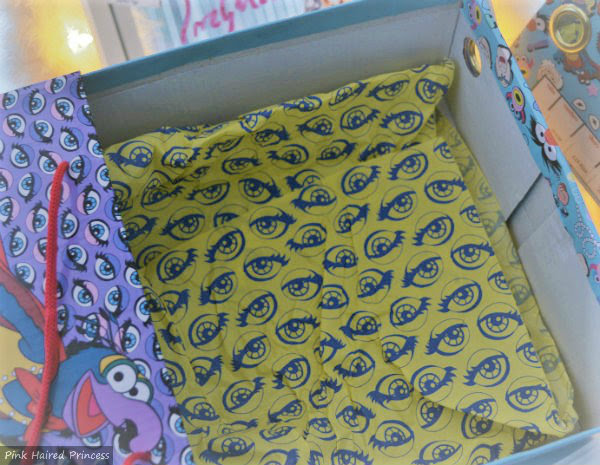 yellow purple eye print tissue paper inside shoe box