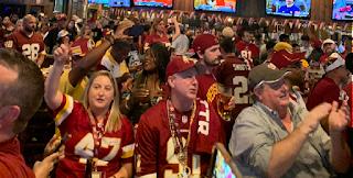 Redskins fans at bar watching their favorite team