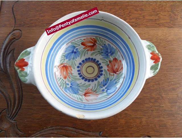 faience lug bowl. Floral design from antique artistic pottery of Malicorne located in France