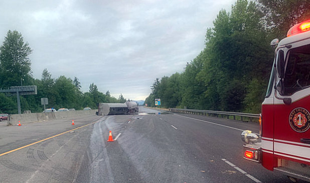 Semi-transverse truck spreads oil on I-5; Driver arrested for DUI