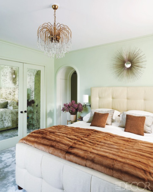 Vintage Touches From The 40s Give This Chic Bedroom An Old Hollywood Glamour A 1940s Chandelier And Starburst Mirror Along With Mirrored Closets