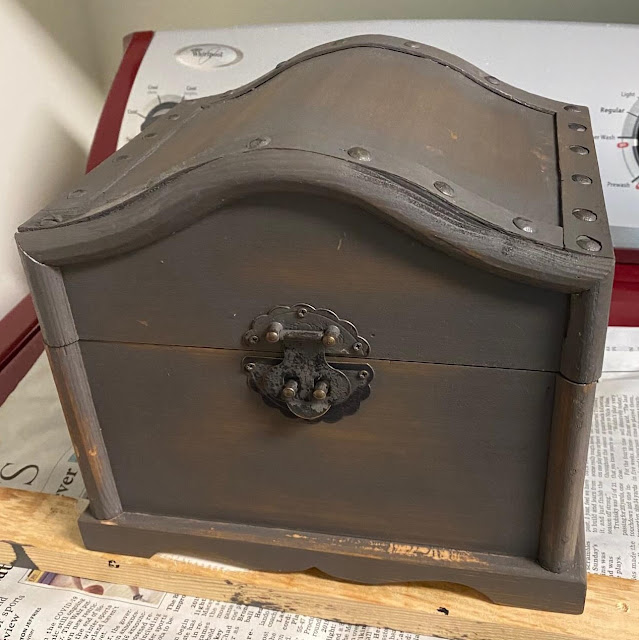 Photo of gray stained wooden treasure chest
