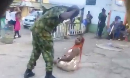 Nigerian soldier flogs woman in public for 'indecent dressing'  VIDEO