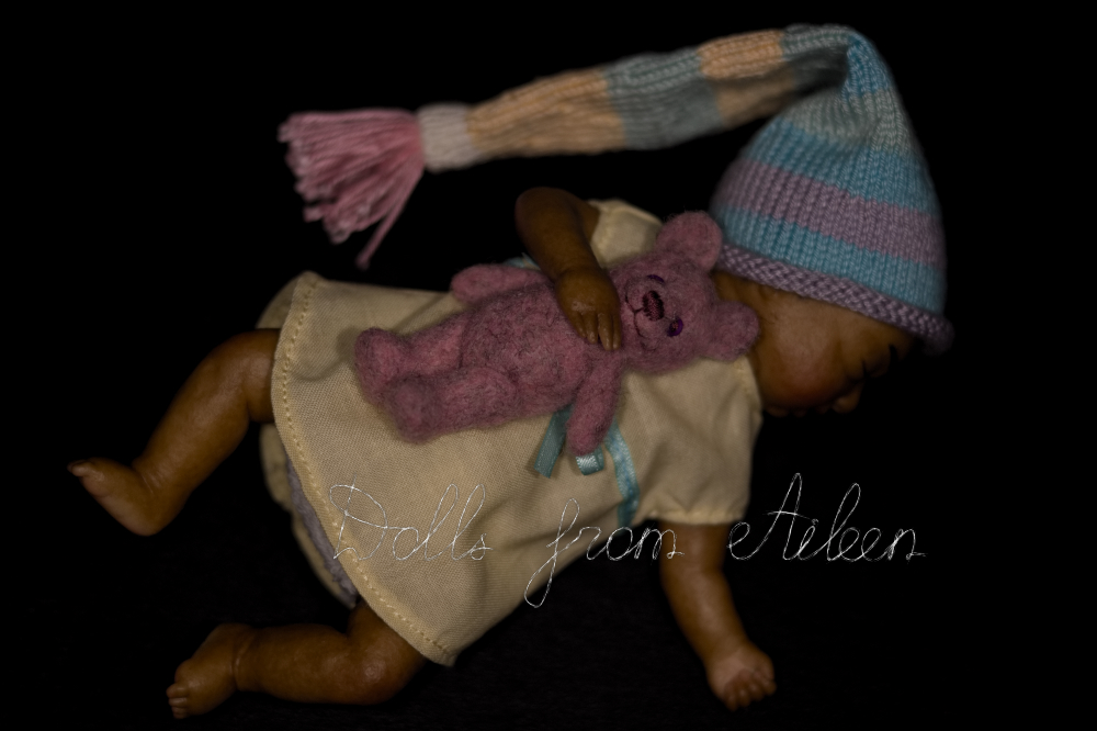 ooak mini sleeping baby doll with her teddy bear