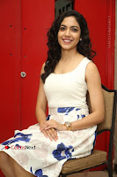 Actress Ritu Varma Stills in White Floral Short Dress at Kesava Movie Success Meet .COM 0233.JPG